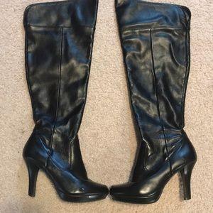 Black heeled knee high boots